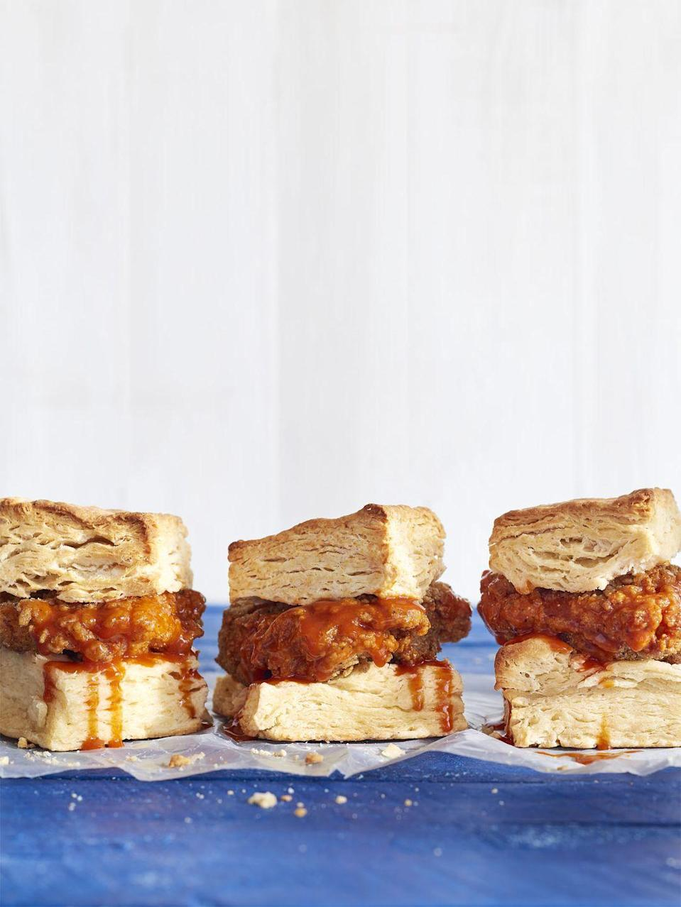 """<p>Are you a chicken and waffles kind of person? If so, you're going to <em>love </em>this.</p><p><strong><a href=""""https://www.countryliving.com/food-drinks/recipes/a41656/mile-high-breakfast-chicken-biscuit-sandwiches-recipe/"""" rel=""""nofollow noopener"""" target=""""_blank"""" data-ylk=""""slk:Get the recipe"""" class=""""link rapid-noclick-resp"""">Get the recipe</a>.</strong></p>"""
