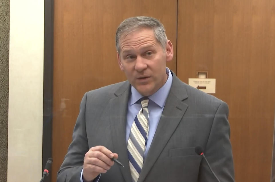In this image from video, prosecutor Steve Schleicher questions Philonise Floyd, brother of George Floyd, as Hennepin County Judge Peter Cahill presides over court Monday, April 12, 2021, in the trial of former Minneapolis police Officer Derek Chauvin, in the May 25, 2020, death of George Floyd at the Hennepin County Courthouse in Minneapolis, Minn. (Court TV via AP, Pool)