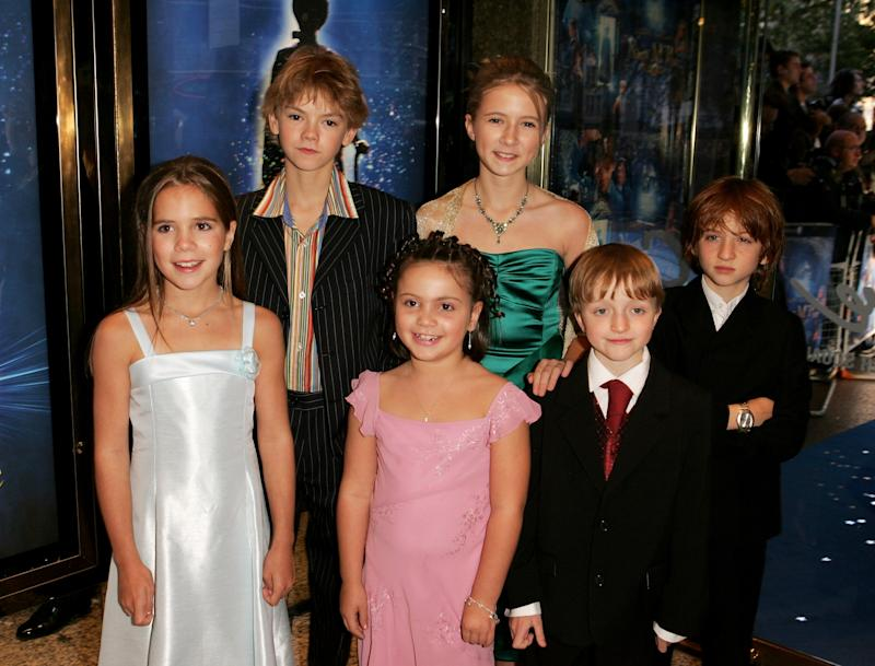 "LONDON - OCTOBER 09: Actors (from left to right) Jennifer Rae Daykin, Thomas Sangster, Holly Gibbs, Eliza Bennett, Sam Honywood and Raphael Coleman arrive at the The World Charity Premiere of ""Nanny McPhee"" in aid of The Refugee Council, at the UCI Empire, Leicester Square on October 9, 2005 in London, England. (Photo by Dave Hogan/Getty Images)"
