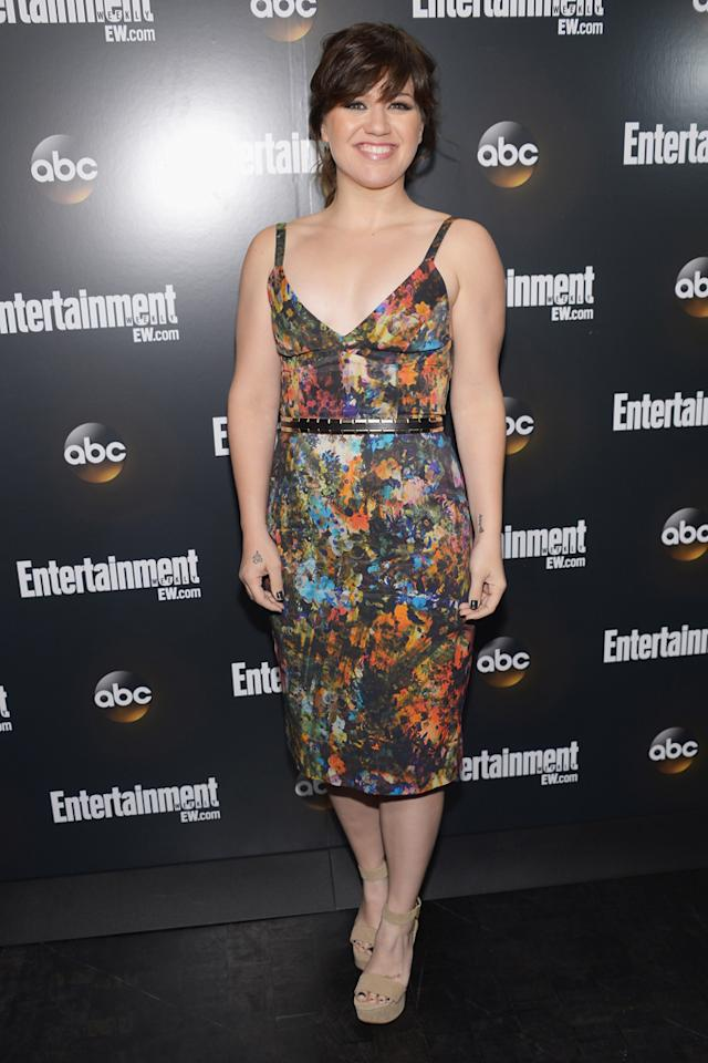 "Kelly Clarkson showed off her newly slimmed down figure in a low-cut, over-the-knee floral dress at ABC's 2012 Upfront Presentation, where she performed with her fellow ""Duets"" co-stars Robin Thicke and John Legend. The original ""American Idol"" winner, who recently turned 30, looked noticeably trimmer, fitter, and more confident as she walked the Entertainment Weekly and ABC Upfront VIP Party's red carpet after her performance. For the past few years, Clarkson's fluctuating weight has attracted a lot of media attention, but the singer has always denied dieting to please critics. ""I'm never trying to lose weight -- or gain it. I'm just being,"" she told <em>Self</em> in 2009. ""When people talk about my weight, I'm like, 'You seem to have a problem with it; I don't. I'm fine!'"""