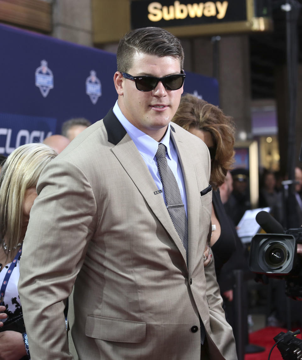 Michigan tackle Taylor Lewan arrives for the first round of the 2014 NFL Draft at Radio City Music Hall, Thursday, May 8, 2014, in New York. (AP Photo/Craig Ruttle)