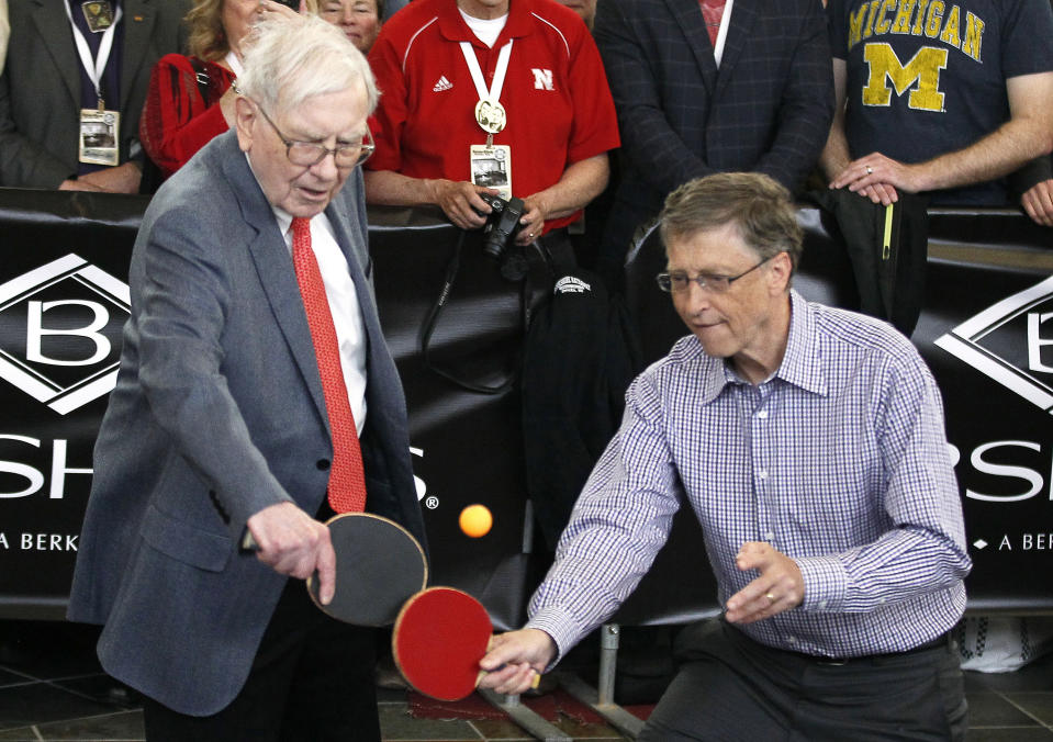 Berkshire Hathaway CEO Warren Buffett (L) plays table tennis with Microsoft Chairman Bill Gates in Omaha May 5, 2013 the day after the company's annual meeting. Buffett at the meeting on Saturday gave the most extensive comments to date about the future of Berkshire Hathaway Inc after he is gone, saying he still expects the conglomerate to be a partner of choice for distressed companies.  REUTERS/Rick Wilking (UNITED STATES - Tags: BUSINESS)