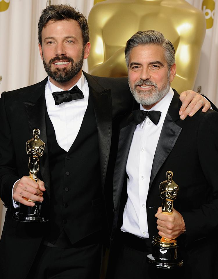 HOLLYWOOD, CA - FEBRUARY 24: Actor/producers Ben Affleck (L) and George Clooney pose in the press room during the Oscars at the Loews Hollywood Hotel on February 24, 2013 in Hollywood, California.  (Photo by Steve Granitz/WireImage)