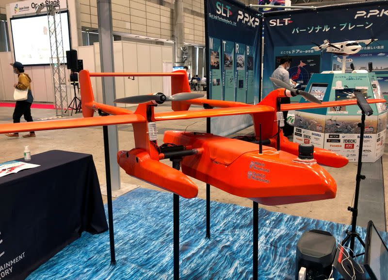An unmanned flying boat named 'HAMADORI' is displayed at Japan Drone 2020 exhibition in Chiba, Japan