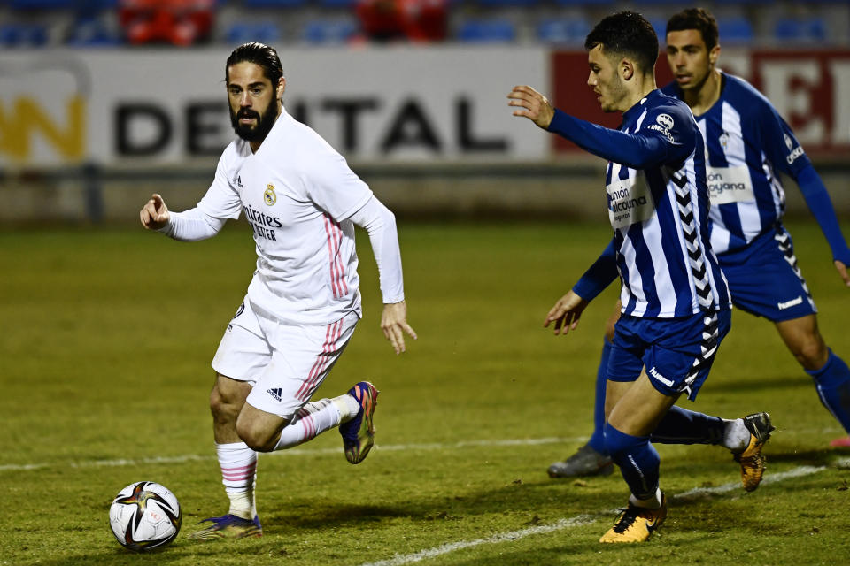 Real Madrid's Isco, left, runs with the ball during a Spanish Copa del Rey round of 32 soccer match between Alcoyano and Real Madrid at the El Collao stadium in Alcoy, Spain, Wednesday Jan. 20, 2021. (AP Photo/Jose Breton)