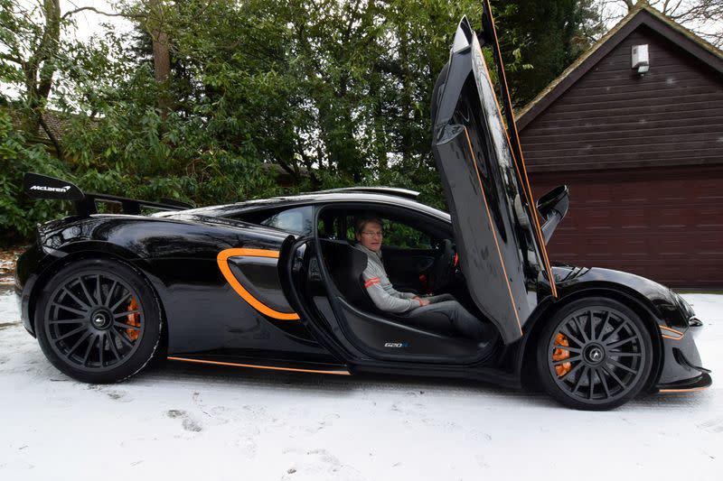 Glynn sits in his most recently acquired McLaren at his home in Headley Down