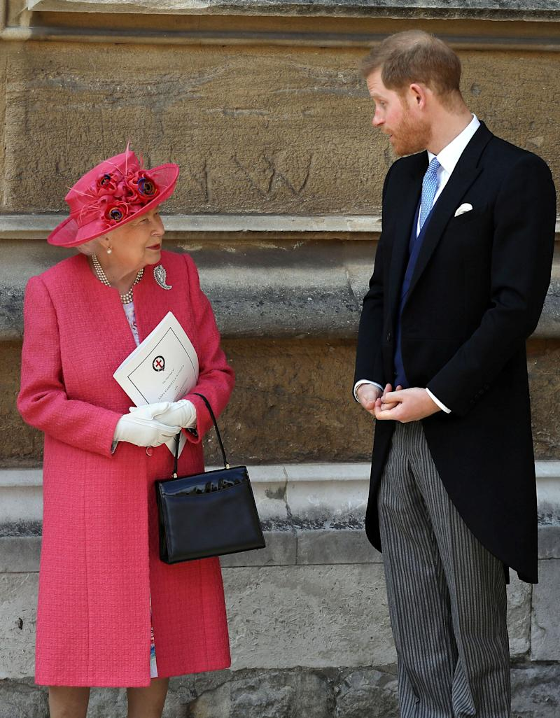 Britain's Queen Elizabeth II (L) and Britain's Prince Harry, Duke of Sussex, leave St George's Chapel in Windsor Castle, Windsor, west of London, on May 18, 2019, after the wedding of Lady Gabriella Windsor and Thomas Kingston. - Lady Gabriella, is the daughter of Prince and Princess Michael of Kent. Prince Michael, is the Queen Elizabeth II's cousin.