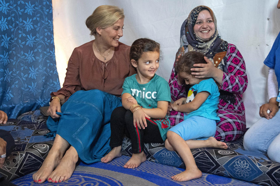 BEKAA VALLEY, LEBANON - JUNE 12: Sophie, Countess of Wessex talks to Asmaa (R) aged 25, and her daughters Sidra, aged 6 (2nd L) and Rim, aged 5 (front) on a visit to an informal tented settlement, during the first official Royal visit to the country, on June 12, 2019 in Bekaa Valley, Lebanon. The Countess of Wessex announced her commitment to supporting the UK's efforts in the Women, Peace and Security agenda (WPS), and the Preventing Sexual Violence in Conflict Initiative (PSVI) earlier this year. (Photo by Victoria Jones - WPA Pool/Getty Images)