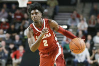 FILE - In this Jan. 22, 2020, file photo, Alabama guard Kira Lewis Jr. plays against Vanderbilt in the first half of an NCAA college basketball game in Nashville, Tenn. Lewis was selected by the New Orleans Pelicans in the NBA draft Wednesday, Nov. 18, 2020. (AP Photo/Mark Humphrey, File)
