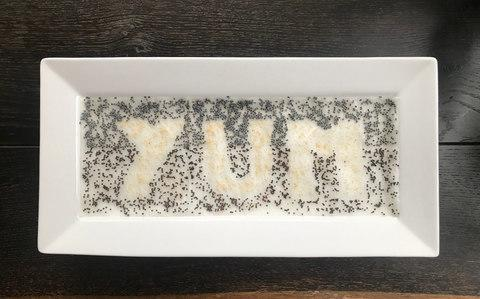"ceramic nibbles plate (£3 from Asda) to grow a design that spells the word ""YUM"" in neon pink amaranth - Credit: Jack Wallington"