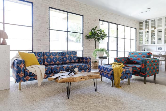 This photo provided by Albany Park shows the Ekaabo seating collection. Albany Park's founder Darryl Sharpton drew on his Nigerian heritage to create his Ekaabo seating collection. The name means 'welcome home', and the velvet upholstery's dynamic blue, orange and burgundy graphics echo West African design. (Melissa Fitzgerald/Albany Park via AP)