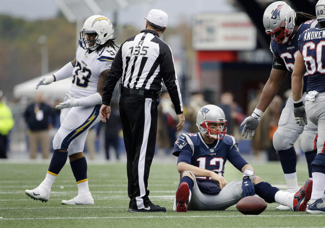 FILE - In this Oct. 29, 2017, file photo, Los Angeles Chargers defensive end Darius Philon, left, celebrates after sacking New England Patriots quarterback Tom Brady (12) during the second half of an NFL football game, in Foxborough, Mass. The Chargers held Tom Brady and New England to just one touchdown in four red zone trips in last year's game. After flummoxing Baltimore last week, Gus Bradley is hoping to come up with another successful game plan this week. (AP Photo/Steven Senne, File)