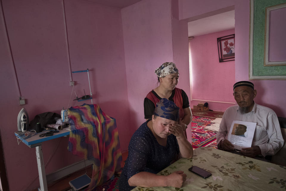 A Kazakh family in their home in the village of Akshi.