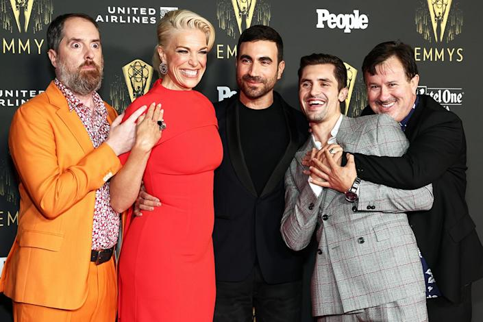 <p>Brendan Hunt, Hannah Waddingham, Brett Goldstein, Phil Dunster and Jeremy Swift celebrate <em>Ted Lasso</em> at the Television Academy's Reception to Honor 73rd Emmy Award Nominees on Sept. 17 in Los Angeles.</p>