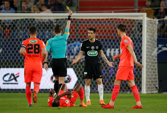 Soccer Football - Coupe de France - Semi-Final - Caen vs Paris St Germain - Stade Michel d'Ornano, Caen, France - April 18, 2018 Paris Saint-Germain's Yuri Berchiche is shown a yellow card by referee Francois Letexier REUTERS/Stephane Mahe