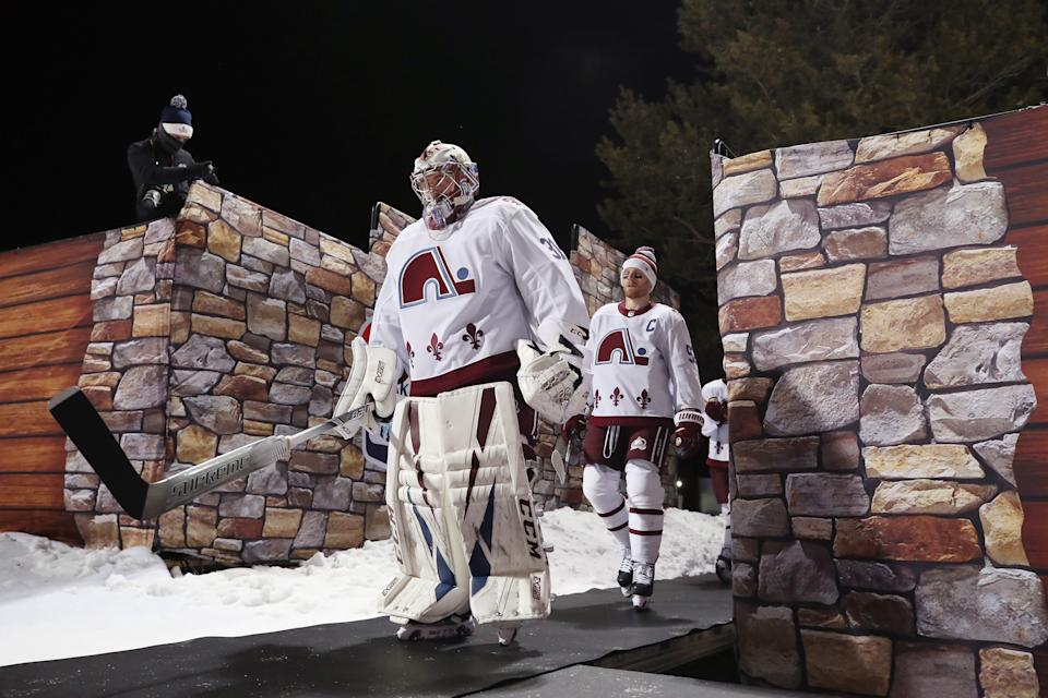 <p>Philipp Grubauer #31 of the Colorado Avalanche leads the team out for warm-ups prior to the second period against the Vegas Golden Knights during the NHL Outdoors at Lake Tahoe at the Edgewood Tahoe Resort on February 20, 2021 in Stateline, Nevada. (Photo by Christian Petersen/Getty Images)</p>