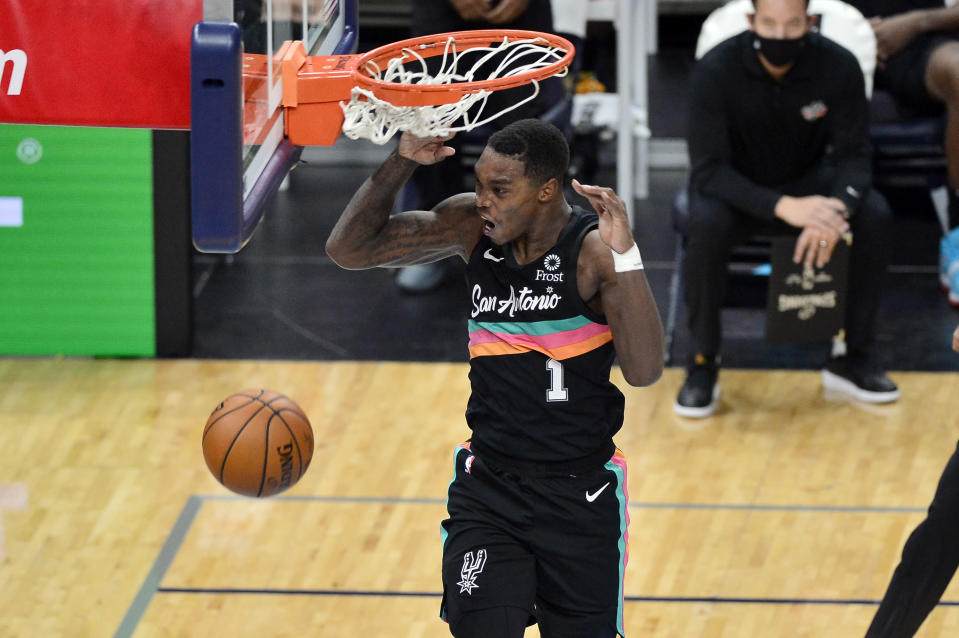 San Antonio Spurs guard Lonnie Walker IV dunks during the second half of the team's NBA basketball game against the Memphis Grizzlies on Wednesday, Dec. 23, 2020, in Memphis, Tenn. (AP Photo/Brandon Dill)