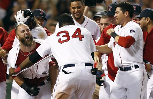 Boston Red Sox's Mike Napoli, left, celebrates his walk-off home run in the 11th inning of a baseball game against the New York Yankees in Boston, early Monday, July 22, 2013. The Red Sox won 8-7. (AP Photo/Michael Dwyer)