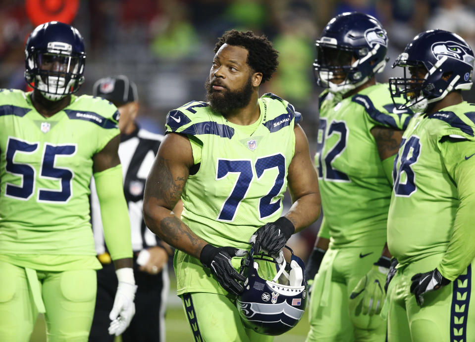 Michael Bennett (72) has sat for the anthem during most games this year. (AP)