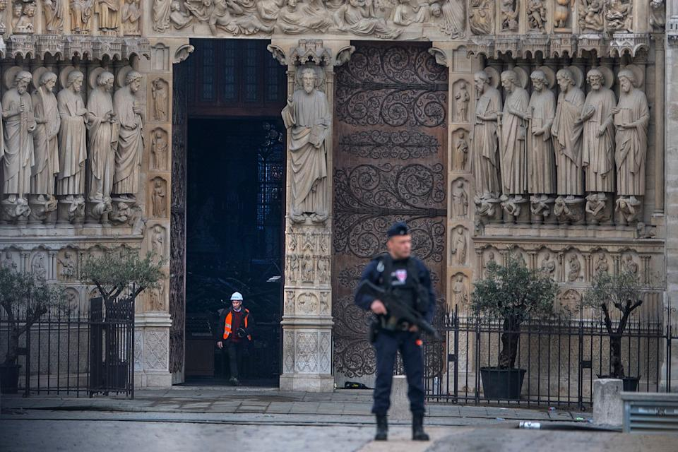 Emergency crew outside the front of the Notre Dame Cathedral in Paris following a fire which destroyed much of the building on Monday evening.