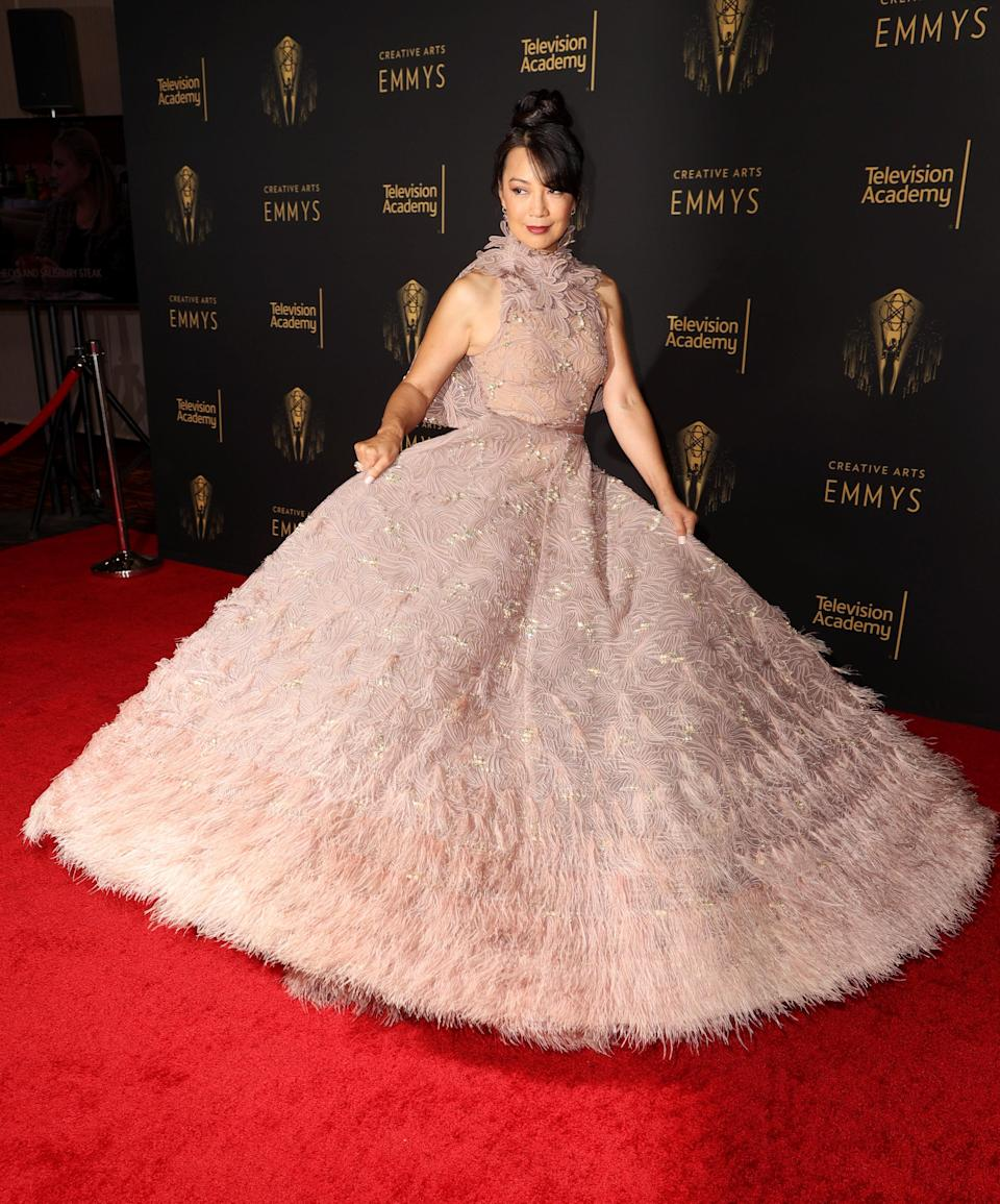 The <em>Mulan</em> star looked like a princess in a ruffled mauve gown.