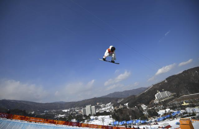 Shaun White flies through the air during qualifying at Phoenix Snow Park. (REUTERS)