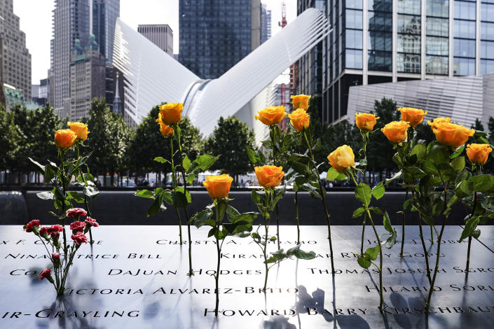 """FILE - Flowers are placed in the inscribed names of deceased at the National September 11 Memorial and Museum, Friday, Sept. 11, 2020, in New York. Museum officials have objected and sought changes to """"The Outsider,"""" a documentary being released this week that reveals disputes that went into development of the Sept. 11 memorial and museum, which opened in 2014. (AP Photo/John Minchillo, File)"""