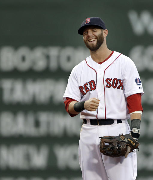Boston Red Sox second baseman Dustin Pedroia smiles during warm-ups for baseball game against the Tampa Bay Rays at Fenway Park in Boston on Tuesday, July 23, 2013. All-Star second baseman Pedroia is close to a contract that could keep him with the Red Sox for his entire big league career. A person with knowledge of the talks said Tuesday that Pedroia is in the process of agreeing to a deal adding $100 million over seven seasons through 2021. The person spoke to The Associated Press on condition of anonymity because the agreement was not yet complete. (AP Photo/Elise Amendola)