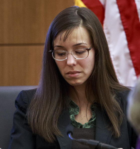 Defendant Jodi Arias describes her relationship with Travis Alexander and answers questions from her attorney Kirk Nurmi as she testifies in her murder trial in Judge Sherry Stephens Superior Court, on Wednesday, Feb. 6, 2013. Arias, 32, is accused of stabbing and slashing Alexander, 27 times, slitting his throat and shooting him in the head in his suburban Phoenix home in June 2008. She initially denied any involvement, then later blamed it on masked intruders before eventually settling on self-defense. (AP Photo/The Arizona Republic, Charlie Leight)