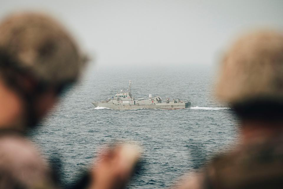 Marines onboard the amphibious transport dock ship USS John P. Murtha (LPD 26) observe an Iranian fast attack craft as it transits the Strait of Hormuz, off Oman, in this undated handout picture released by U.S. Navy on August 12, 2019. Donald Holbert/U.S. Navy/Handout via REUTERS ATTENTION EDITORS- THIS IMAGE HAS BEEN SUPPLIED BY A THIRD PARTY.