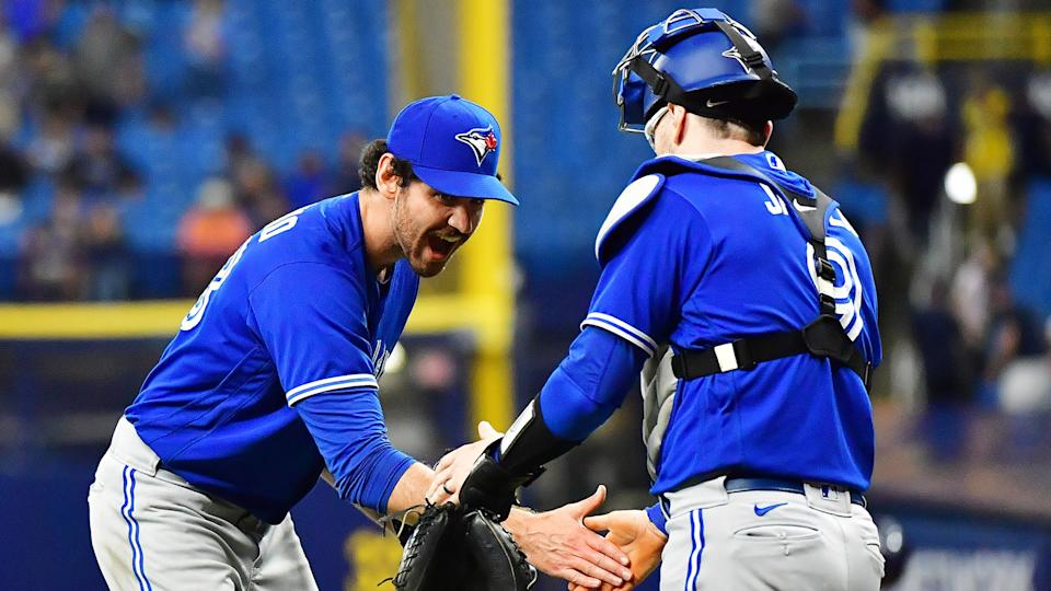 Jordan Romano #68 celebrates with Danny Jansen #9 of the Toronto Blue Jays after defeating the Tampa Bay Rays. (Photo by Julio Aguilar/Getty Images)