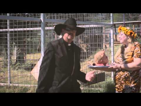 "<p>Perhaps Joe Exotic's most-famous music video to date, it shows a woman, who resembles Carole Baskin, feeding raw meat to a tiger, while Joe sings alongside her. <br></p><p><a href=""https://www.youtube.com/watch?v=lCgz9915wHw&t=127s"">See the original post on Youtube</a></p>"
