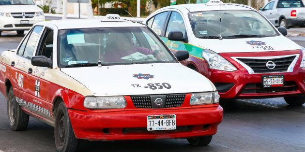 Campeche, Mexico - May 20, 2017: Taxi cars Nissan Tsuru and Nissan Versa in the city street.