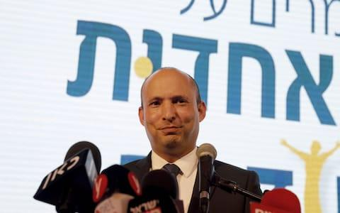 Education Minister Naftali Bennett demanded to be given the defence portfolio, threatening to withdraw his eight seats from Mr Netanyahu's governing coalition - Credit: MENAHEM KAHANA/AFP/Getty Images