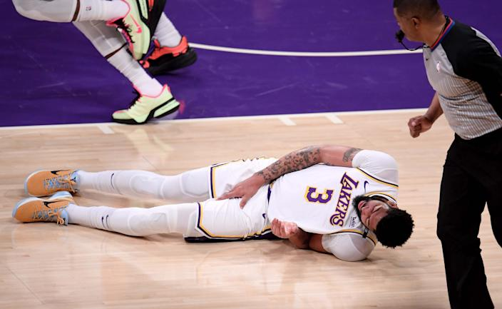 Anthony Davis #3 of the Los Angeles Lakers falls to the floor grabbing his leg against the Phoenix Suns in the first half of game four of the Western Conference First Round NBA Playoff basketball game at the Staples Center in Los Angeles on Sunday, May 30, 2021. (Photo by Keith Birmingham/MediaNews Group/Pasadena Star-News via Getty Images)