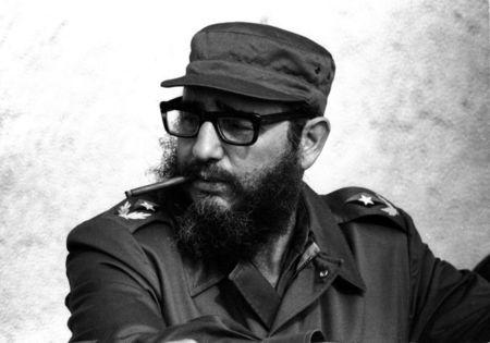 Then Cuban Prime Minister Fidel Castro attends manoeuvres during the 19th anniversary of his and his fellow revolutionaries arrival on the yacht Granma, in Havana in this November 1976 file photo. REUTERS/Prensa Latina/File Photo