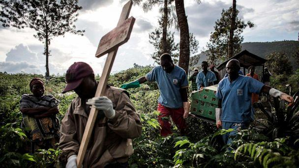 PHOTO: Health workers carry a coffin containing a victim of the Ebola virus, May 16, 2019, in Butembo in the Democratic Republic of Congo. (John Wessels/AFP/Getty Images)