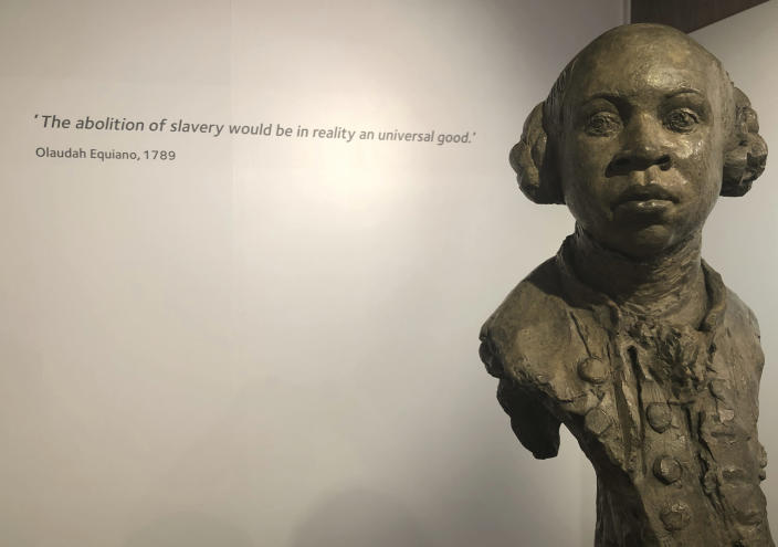 In this Nov. 24, 2019 photo, a sculpture of former slave and later abolitionist, writer Olaudah Equiano by London based artist Christy Symington, sits on display at the International Slavery Museum in Liverpool, England, Britain. Activists and towns in the U.S. are left wondering what to do with empty spaces that once honored historic figures tied to racism as statues and monuments fell in June 2020. The Equiano image has been suggested as a replacement. (AP Photo/Russell Contreras)