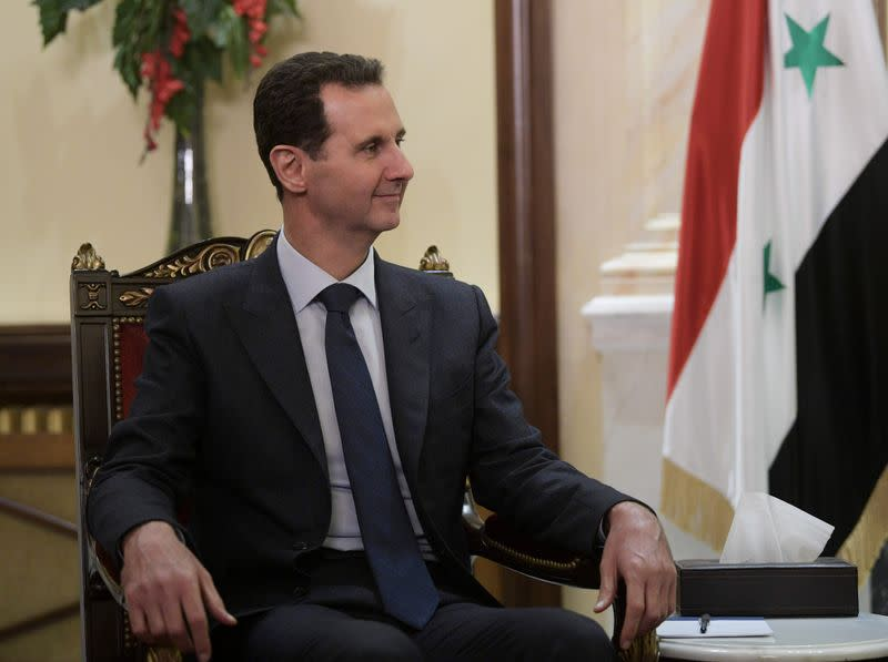 FILE PHOTO: Syrian President Assad meets his Russian counterpart Putin in Damascus