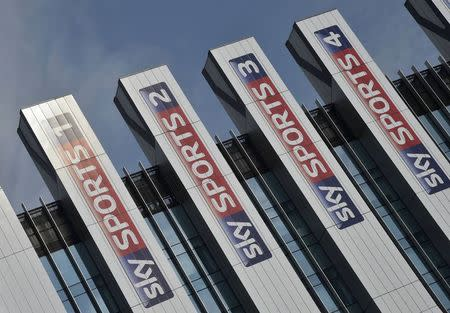 Sky Sports logos are seen on the side of offices at their UK company headquarters in west London July 25, 2014. Britain's BSkyB has agreed to pay 4.9 billion pounds ($8.3 billion) in cash to buy Rupert Murdoch's pay-TV assets in Germany and Italy, responding to slowing growth at home by creating a European media powerhouse. REUTERS/Toby Melville