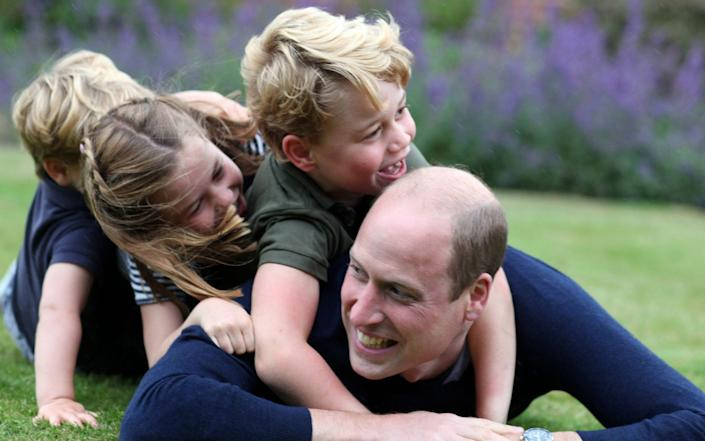 The Duchess's snap of William with Prince George, Princess Charlotte and Prince Louis - The Duchess of Cambridge/Kensington Palace/AFP