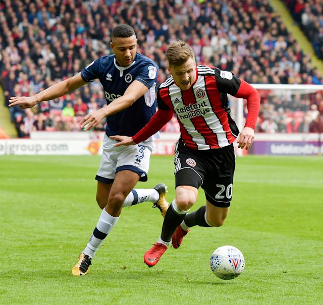 "Soccer Football - Championship - Sheffield United vs Millwall - Bramall Lane, Sheffield, Britain - April 14, 2018 Sheffield United's Lee Evans in action with Millwall's James Meredith Action Images/Paul Burrows EDITORIAL USE ONLY. No use with unauthorized audio, video, data, fixture lists, club/league logos or ""live"" services. Online in-match use limited to 75 images, no video emulation. No use in betting, games or single club/league/player publications. Please contact your account representative for further details."