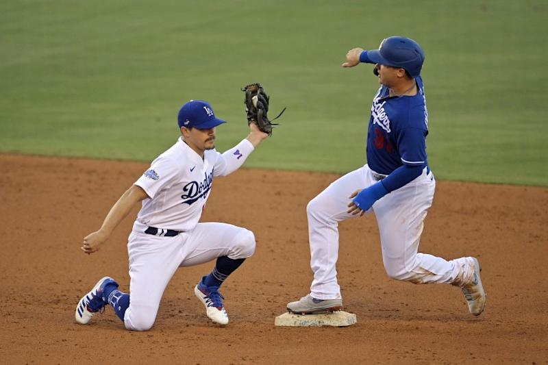 Los Angeles Dodgers' Joc Pederson, right, is safe at second on a steal after Enrique Hernandez put a late tag on him during an intrasquad baseball game Thursday, July 9, 2020, in Los Angeles. (AP Photo/Mark J. Terrill)