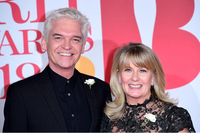 Phillip Schofield and Stephanie Lowe attending the Brit Awards at the O2 Arena, London. (Photo by Ian West/PA Images via Getty Images)