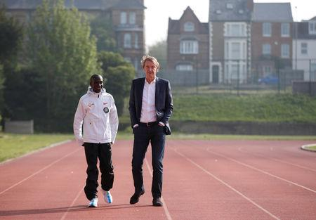 Athletics - Eliud Kipchoge reveals plans to break two hour marathon record - Iffley Road Sports Centre, Oxford, Britain May 6, 2019. Kenya's Eliud Kipchoge speaks with Sir Jim Ratcliffe REUTERS/Andrew Boyers