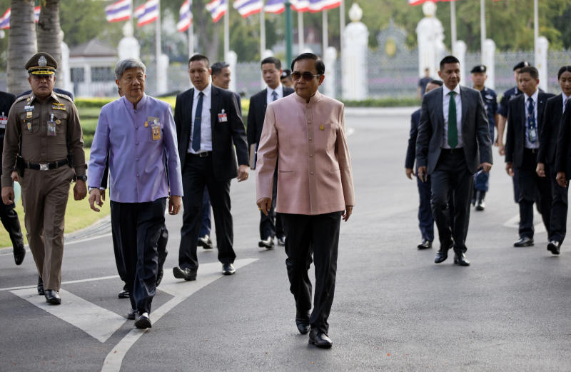 In this Tuesday, March 5, 2019. Thai Prime Minister Prayuth Chan-ocha arrives at the Government House before a cabinet meeting in Bangkok, Thailand. Prayuth became prime minister in a very Thai way: He led a military coup. Now after five years of running Thailand with absolute power, he's seeking to hold on to the top job through the ballot box. (AP Photo/Sakchai Lalit)