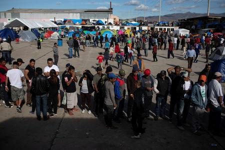 FILE PHOTO:  Migrants, part of a caravan of thousands from Central America trying to reach the United States, line up in a temporary shelter in Tijuana