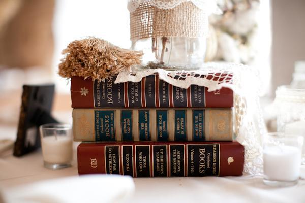 "<div class=""caption-credit""> Photo by: Nathan Westerfield Photography</div>Find books in your color scheme and stack them together for an easy, budget-friendly centerpiece or table decor. <br> <a href=""http://lover.ly/explore/decor?q=centerpiece&utm_source=shine09-29-2013library&utm_medium=guest&utm_campaign=shine09-29-2013library"" rel=""nofollow noopener"" target=""_blank"" data-ylk=""slk:More ideas for charming centerpieces"" class=""link rapid-noclick-resp"">More ideas for charming centerpieces</a> <br> Photo by: <a href=""http://r.lover.ly/redir.php/OyYmloWD29o_aHR0cDovL3d3dy5uYXRoYW53ZXN0ZXJmaWVsZC5jb20v"" rel=""nofollow noopener"" target=""_blank"" data-ylk=""slk:Nathan Westerfield Photography"" class=""link rapid-noclick-resp"">Nathan Westerfield Photography</a> on <a href=""http://r.lover.ly/redir.php/TsIsGZdnlhs_aHR0cDovL2lsb3Zlc3dtYWcuY29tLzIwMTIvMDQvMDkvZmFzaGlvbmFibGUtY2hhcmxlc3Rvbi13ZWRkaW5nLWJ5LW5hdGhhbi13ZXN0ZXJmaWVsZC8="" rel=""nofollow noopener"" target=""_blank"" data-ylk=""slk:Southern Weddings"" class=""link rapid-noclick-resp"">Southern Weddings</a> via <a href=""http://lover.ly/image/124225"" rel=""nofollow noopener"" target=""_blank"" data-ylk=""slk:Lover.ly"" class=""link rapid-noclick-resp"">Lover.ly</a>"