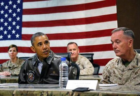 U.S. President Obama sits for a military briefing with U.S. Marine General Dunford at Bagram Air Base