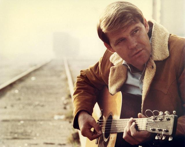 "<p>Glen Campbell was best known for a string of country-pop hits in the '70s, including ""Rhinestone Cowboy"" and ""Wichita Lineman,"" as well as his popular TV show ""The Glen Campbell Goodtime Hour."" He died Aug. 8 from Alzheimer's disease. He was 81.<br> (Photo: Getty Images) </p>"